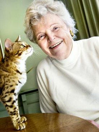 Jean Mill - Mill posing with a Bengal cat