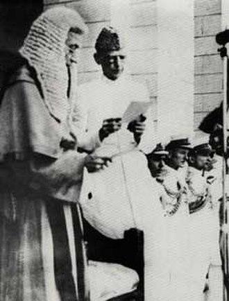 Mian Abdul Rashid - Rashid (left) swearing-in Muhammad Ali Jinnah as Governor-General