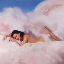 The album cover depicts Katy Perry lying naked on clouds of cotton candy.