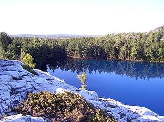 La Cloche Silhouette Trail - The clear mountain lakes of the Killarney Ridge turn bright blue in the sun.