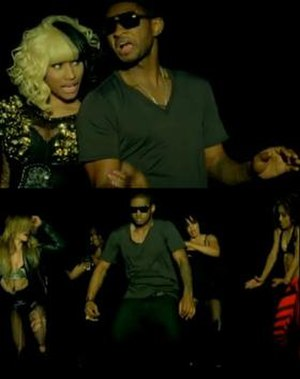 Lil Freak - Usher in front of a backdrop with Minaj and dancing and being flaunted by dancers.