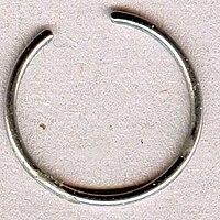 Dried sebum deposit on body jewelry.