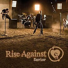 "Cover art for the single ""Savior"" by Rise Against. The cover features a picture of three guitar players and one drummer, performing in a dirt lot."