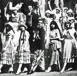 As Rene (centre) in A Night Out (1920) Stanley-Holloway-as-Rene-in-a-night-out.jpg