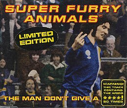 "A dark-haired man in blue, white and yellow football kit scowls as he turns to his left, holding the index and middle fingers up on his right hand, his palm facing inwards. The hand points to an out-of-image figure, but appears to be pointing to the viewer. ""Super Furry Animals"" is rendered in yellow and red text across the top, while along the bottom the single's title is partially given: ""The Man Don't Give a ****"". The final word is obscured by a sticker, which itself claims that the word is used 50 times during the song"