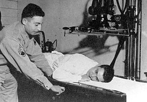 David Grant USAF Medical Center - A U.S. Army Air Force Staff Sergeant Radiologic Technologist (Radiographer) positions a patient for an X-ray at the 4167th Station Hospital at Fairfield-Suisun Army Air Field during WWII, circa 1943-1945