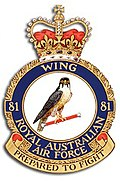"Military crest for 81 Wing, Royal Australian Air Force, with crown atop and hawk in centre; the motto reads ""Prepared to fight"""