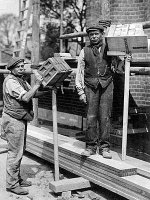 Brick hod - Twin brothers Albert and Ebenezer Fox each holding a hod