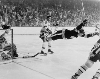"Boston Bruins - Orr is tripped and flies through the air after scoring ""The Goal"" in overtime to win the 1970 Stanley Cup Finals. The image is widely considered to be one of the most famous in hockey history."