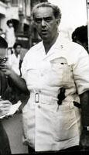 David Marshall (Singaporean politician) - David Marshall, wearing his political uniform of white bush-jacket and grey trousers, with a hammer