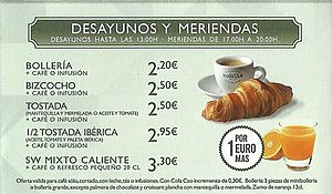 Time in Spain - A Spanish advertisement offering breakfasts until 1pm and meriendas (tea) from 5pm to 8pm. It shows Spain's habit of late meals.