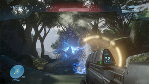 Halo 3 - Master Chief aims his Assault Rifle at a group of Covenant Grunts. A piece of activated equipment, called the bubble shield, is shown.