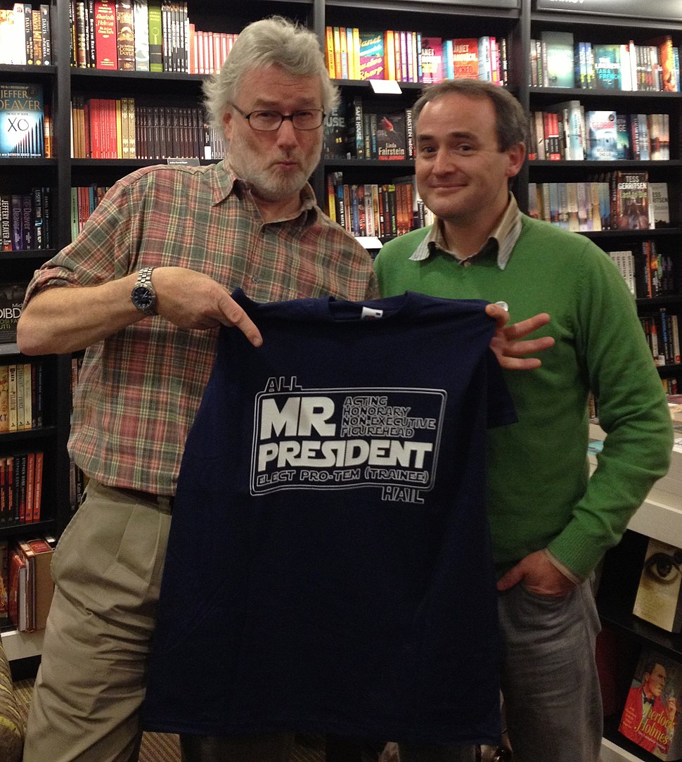 Mr Iain M Banks accepting a T shirt conferring the title Acting Honorary Non-Executive Figurehead President Elect pro tem (trainee) of the ScienceFictionBookClub.org - October 2012