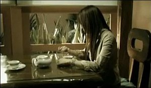 Someday (Nina Girado song) - A scene from the music video, where Nina is seen sitting on a dining table.