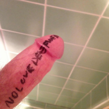"A photograph of male genitalia, with the words ""NO LOVE DEEP WEB"" written on it."