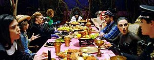 Nobody's Perfect (Jessie J song) - Jessie J sitting in a feast table referencing the Mad Hatters' tea party.