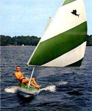 Sailfish (sailboat) - Alcort Sailfish depicting the sit-upon sailing posture, the shallow draft hull, and the characteristic lateen sail, c1963