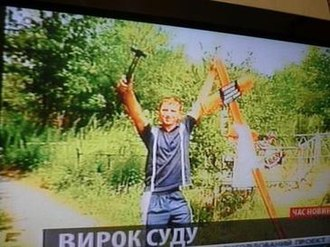 "Dnepropetrovsk maniacs - Suprunyuk photographed with a hammer; the court described the motive of the killers as ""morbid self-affirmation""."