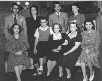 George Ansbro - The cast of Young Widder Brown with Florence Freeman, who had the title role, seated in the middle and announcer George Ansbro at top left.