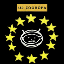 A white outline of a baby's head inside of an oval space helmet, set against a black background. The baby looks directly at the viewer. Twelve yellow five-pronged stars encircle the baby's head. Above the stars is a golden coloured rectangular box with the words U2 and Zooropa written in black capital letters inside of it.