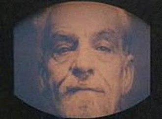 Emmanuel Goldstein - Emmanuel Goldstein on a telescreen in Michael Radford's ''1984'' film adaptation. Played by actor John Boswall.