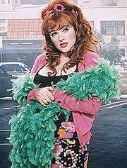 Julie Brown as Tammi Tyler in Strip Mall (2000)