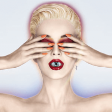 Katy Perry with blond short hair. She covers her eyes with her hands as an eyeball is visible inside her mouth as her lips are slightly parted.