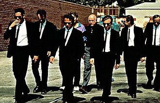"Reservoir Dogs - The film's opening sequence, a slow-motion scene playing ""Little Green Bag"" by the George Baker Selection."