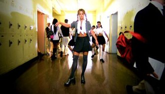 ...Baby One More Time (song) - Spears wearing the schoolgirl outfit in the song's music video