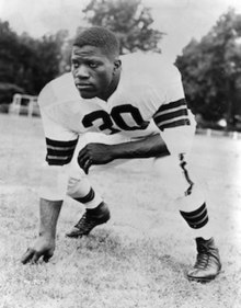 Willis shown in uniform in a lineman's stance in a 1951 publicity photo