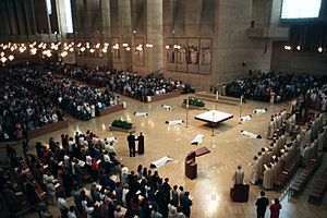 Prostration - White-clad deacon candidates prostrate before the altar of the Cathedral of Our Lady of the Angels in Los Angeles during their ordination liturgy