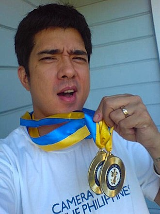 Francis Magalona - Magalona holds up two medals awarded by the Camera Club of the Philippines