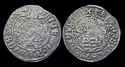 Silver Saxony coin of Frederick III, known as a Groschen, minted ca. 1507–25. Both the obverse and the reverse bear a coat of arms.