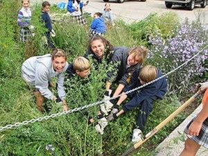 Center for Neighborhood Technology - Students at St. Margaret Mary plant a rain garden