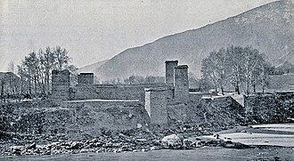 Shuja ul-Mulk - The Chitral Fort from across the river with its towers visible (1895).