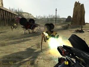 Half-Life 2 - A screenshot of the player engaging a group of antlions with a pulse rifle. Along the bottom of the screen, the player's health, suit charge level, and their ammunition are displayed.