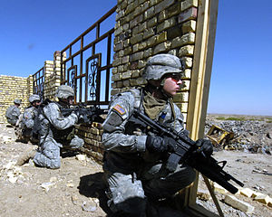 172nd Infantry Brigade (United States) - Soldiers from the 172nd Stryker Brigade Combat Team prepare to cross an open field during a cordon and search mission in Ur, Iraq in 2006.