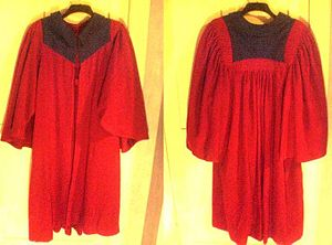 Undergraduate gowns in Scotland - University of Dundee gown on a hanger, obverse and reverse shown