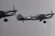 dc449b1e30df Curtiss-Wright test pilots flew P-40E fighters in the live action aerial  scenes.