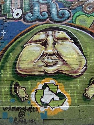 Slum tourism - Signed street graffiti awaits urban tourists in Montreal.