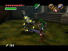 The adult version of Link, armed with a sword and shield and wearing a green tunic, is fighting a bipedal wolf in front of the Forest Temple. Link's fairy companion, Navi, has turned yellow and hovers above the creature, which is now surrounded by yellow crosshair-like arrows.