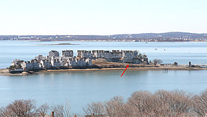 Fort Duvall - A 2010 view, looking westward at Hog Island, the site of Fort Duvall. Later the site was purchased, covered with condominiums, and renamed Spinnaker Island. The arrow points to the casemate of Gun 2 of Battery Long, which is now a parking garage.