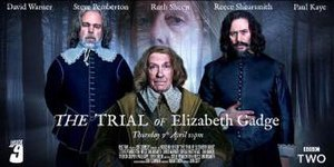The Trial of Elizabeth Gadge - A poster for the episode, featuring Steve Pemberton as Mr. Clarke, David Warner as Sir Andrew Pike, and Reece Shearsmith as Mr. Warren. Ruth Sheen, as Elizabeth Gadge, is visible in the background.