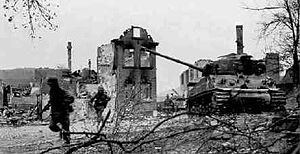 Task Force Baum - U.S. 14th Armored Division Infantry of the 19th Armored Infantry Bn. with supporting M4 medium tanks from the 47th Tank Bn. (both units of the 14th Armored Division), during the successful drive to Hammelburg, 5 April 1945, following the failed Baum Task Force of March.