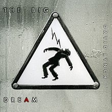"A signpost with an image of a man being struck by electricity. White text surrounding it reads ""The Big Dream David Lynch""."