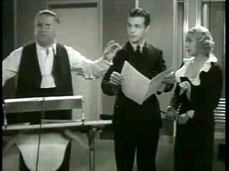 Leo F. Forbstein - Leo Forbstein conducts Dick Powell as Joan Blondell looks on in Broadway Gondolier (1935).