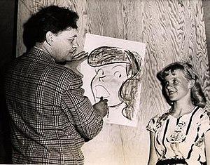 Harry Haenigsen - Harry Haenigsen is seen drawing his character Penny Pringle in this photo by Maynard Clark.