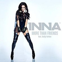 Photograph of Inna posing in front of a white backdrop wearing a black top along with black latex boots. The title of the song and its artists are shown on the right.