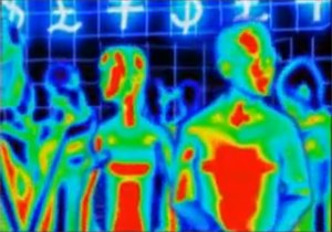 """Juxtapozed with U - The promotional video for """"Juxtapozed with U"""" features a woman and a man seen as thermal images. This screenshot shows the pair visiting a nightclub with mathematical symbols and currency signs on the walls."""