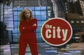 The City (1995 TV series) - An image from the first opening title sequence of The City (Morgan Fairchild pictured as Sydney Chase).